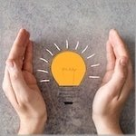 energy efficiency hands with bulb