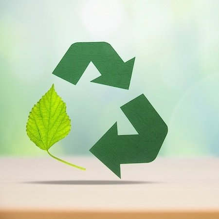 green recycling symbol with leaf