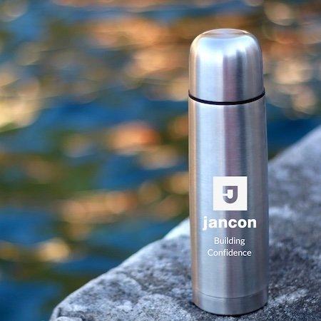 Reusable mug with Jancon logo and tagline Building Confidence